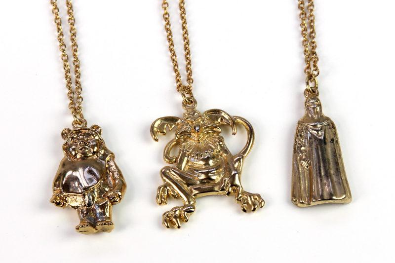 Adam Joseph Inc - gold tone ROTJ necklaces