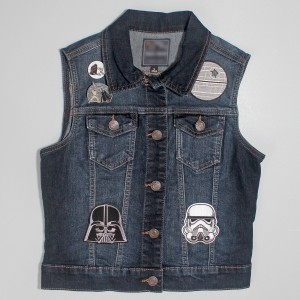 Denim vest with Star Wars patches and pins