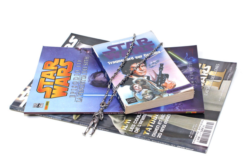 Han Cholo Stormtrooper necklace with International Star Wars books