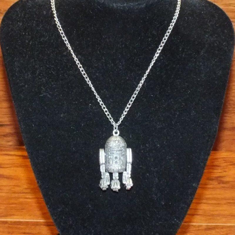 Vintage Star Wars 1977 R2-D2 necklace on eBay